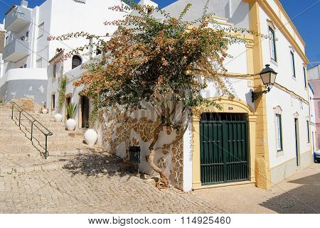 View to the street with traditional white buildings in Estoi (Faro district), Portugal.