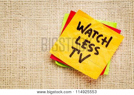 watch less TV reminder on a sticky note against burlap canvas