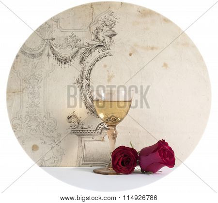 old glass of white wine with rose on the decorative background