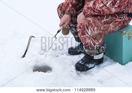 fisherman on winter fishing