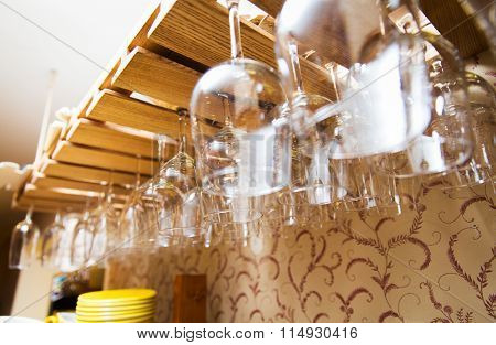 wine glasses hanging upside down on bar holder