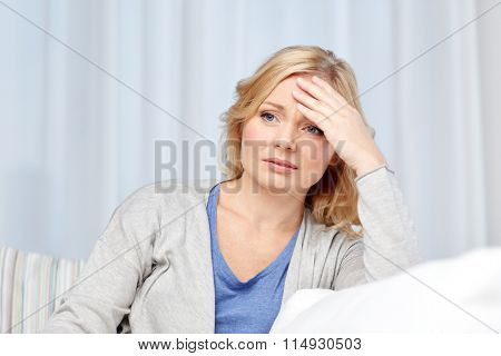 woman suffering from headache at home