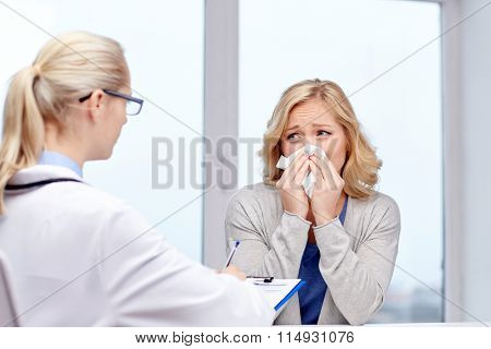 doctor and ill woman patient with flu at clinic