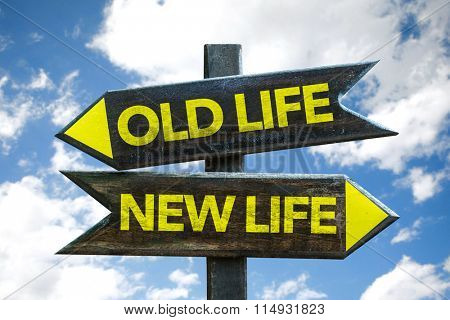 Old Life - New Life signpost with sky background