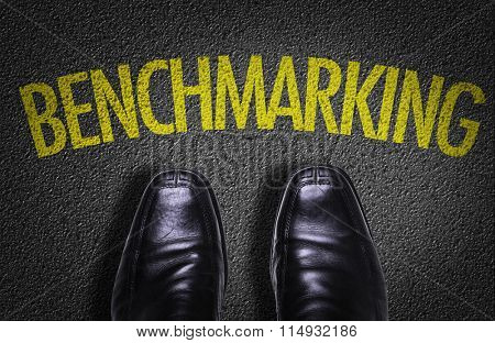 Top View of Business Shoes on the floor with the text: Benchmarking
