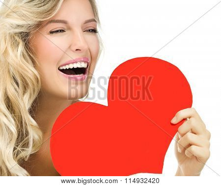 beauty portrait of attractive young caucasian smiling woman blond isolated on white studio shot toothy smile face long hair head and shoulders face skin red heart valentine's love