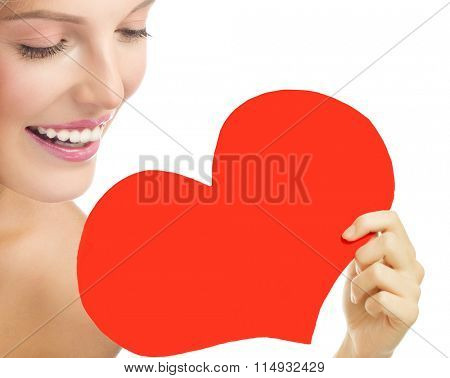 beauty portrait of attractive young caucasian smiling woman blond isolated on white studio shot  toothy smile face skin red heart valentine's love