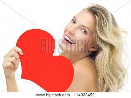 beauty portrait of attractive young caucasian smiling woman blond isolated on white studio shot lips toothy smile face long hair head and shoulders looking at camera red heart valentine's love