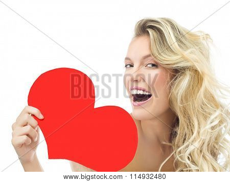 beauty portrait of attractive young caucasian smiling woman blond isolated on white studio shot  toothy smile face long hair head and shoulders looking at camera red heart valentine's love