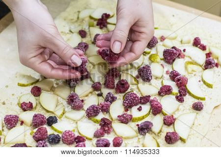 background woman preparing strudel of pears and berries