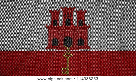 Flag of Gibraltar painted on stitch texture