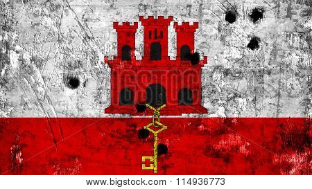 Flag of Gibraltar painted on metal with bullet holes