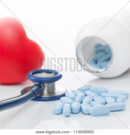 Stethoscope, Bottle Of Pills And Red Heart On Table - Studio Shoot On White