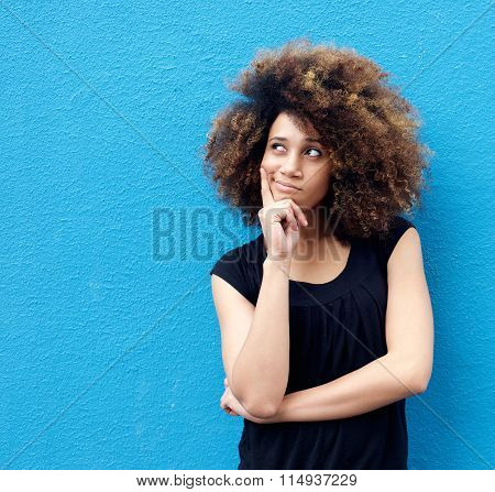 Young African American Woman With Afro Thinking