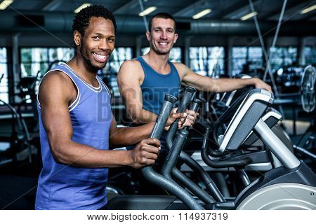 Two men working out together at the gym