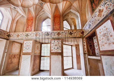 Faded Frescoes On The Walls Of Historical Palace In Isfahan