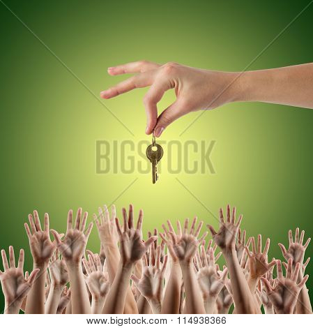 REAL ESTATE concept. Many hands want to get the key, reaching ou