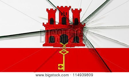 Flag of Gibraltar painted on broken glass
