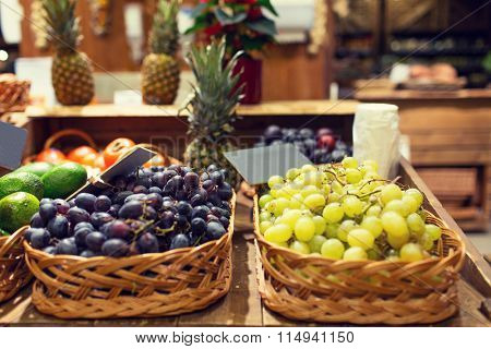 grape in baskets with nameplates at food market