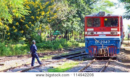 BAGO, MYANMAR - November 16, 2015: Train arriving at Bago trainstation in Myanmar. The quality of the railway infrastructure is generally poor.