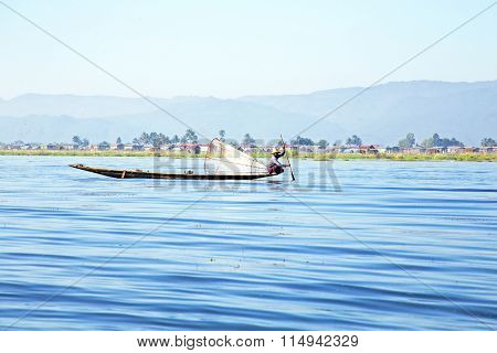 INLE LAKE, MYANMAR - NOVEMBER 15, 2015: Fisherman on Inle Lake, Myanmar on the 15th November, 2015