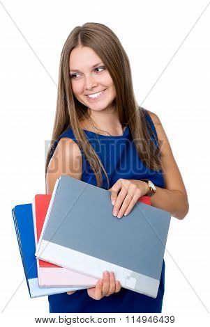 Cheerful Girl In A Blue Dress With Folders For Documents Looks Away