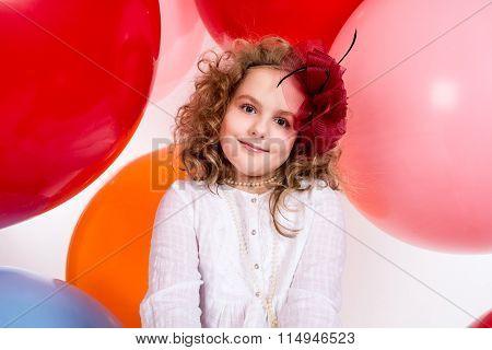 Happy Joyful Beautiful Girl On A Background Of The Larger Balls.