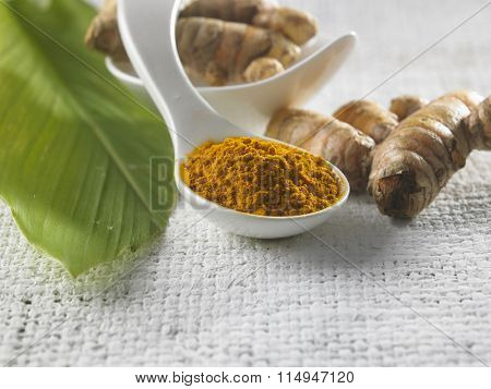turmeric,powder  and leaf on the wooden background