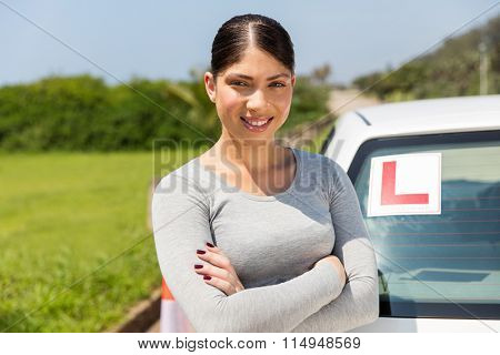 portrait of happy student driver with arms crossed