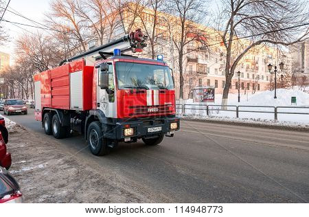 Red Firetruck Iveco Speeding Down A Street To A Call In Samara, Russia
