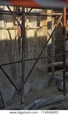 Laborer Spraying Mixture