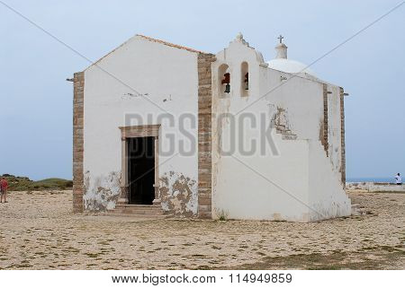 People visit church of Our Lady of Grace at Sagres point in Sagres, Portugal.