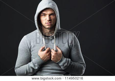 Portrait Of Brutal Looking Young Guy In Sportswear.