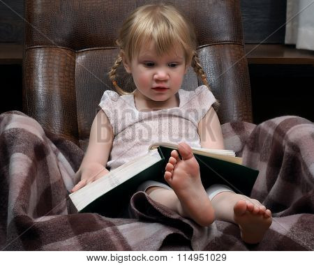 Little girl with a large book.