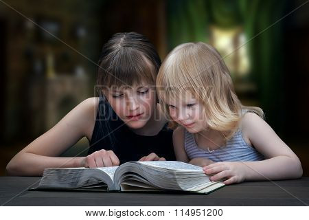 Children reading the book