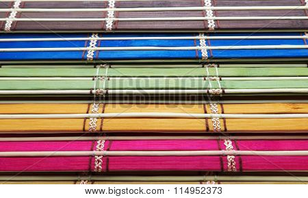 Colorful weave background. Focus on different green at center.