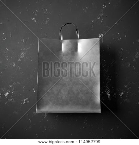 Concept of black packet bag on the dark background. 3d render