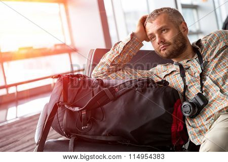 Portrait of male tourist at the airport