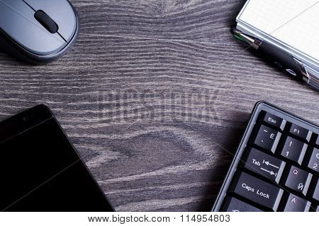 The keyboard, a mouse, the smartphone, a notebook and the handle