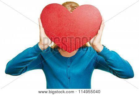 Anonymous woman hold big red heart in front of her face