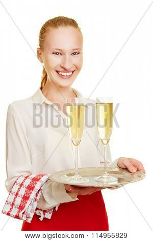 Smiling female waiter serving champagne in glasses on a tray