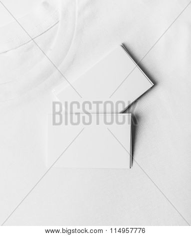 Set of blank business cards on white tshirt. Vertical