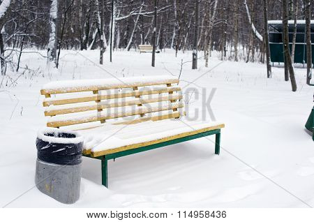 Yellow Bench And Trashcan In Snow