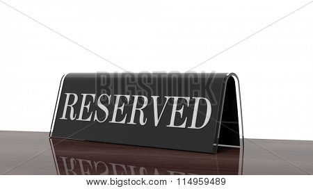 Black glossy reservation sign on wooden surface, isolated on white background.