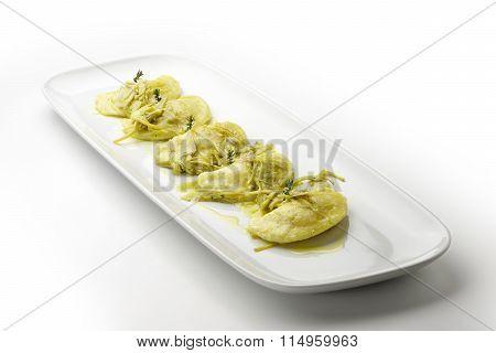 Potato Ravioli Stuffed With Lobster And Artichokes Plug Stews