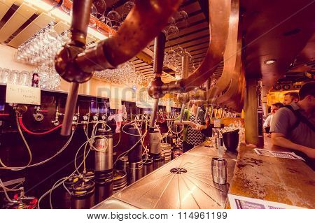 BRUSSELS, BELGIUM - 11 AUGUST, 2015: Beer taps at Delirium Bar showing advanced tapping system and l