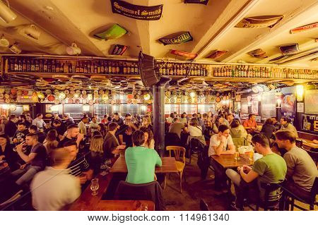 BRUSSELS, BELGIUM - 11 AUGUST, 2015: Famous Delirium Bar inside overview crowded room of people enjo