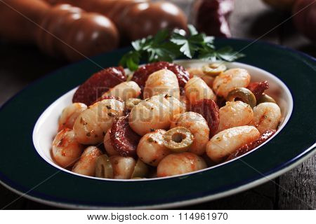 Gnocchi di patata, italian potato noodle with tomato sauce, sausage and olives