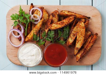 Roasted potato wedges with salsa and onion dip