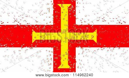 Flag of Guernsey with water drops